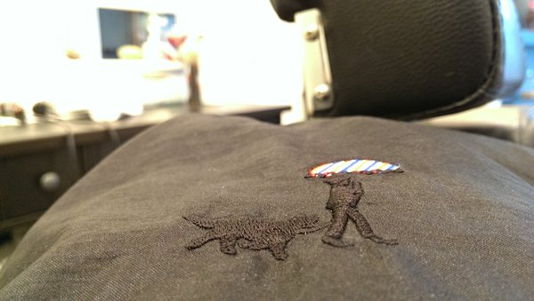 Mr. Hobbs embroidered onto the barber capes